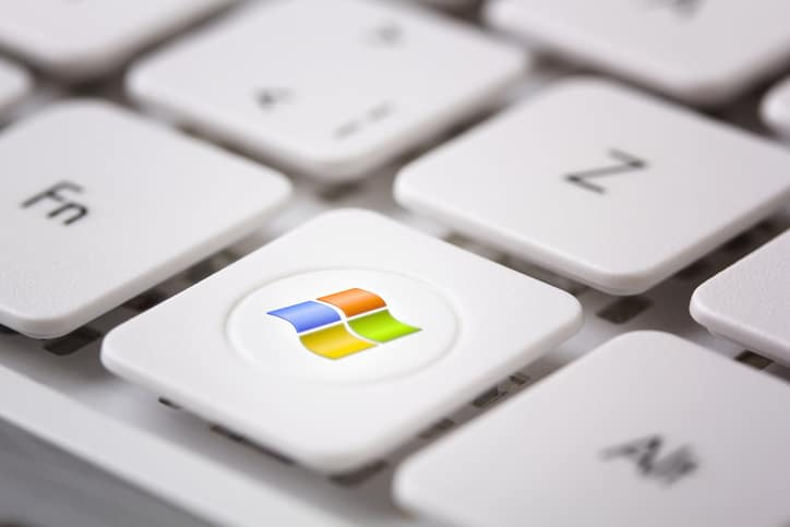 Windows logo on keyboad. Microsoft Windows is a series of operating systems produced by Microsoft.